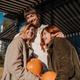 Girls holds pumpkins in hands. Outdoor photo - PhotoDune Item for Sale