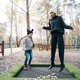 Mom and her daughter jumping together on trampoline in autumn park - PhotoDune Item for Sale
