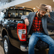 Happy man poses in the back of new pickup truck - PhotoDune Item for Sale