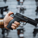 Man choosing new handgun in gun shop - PhotoDune Item for Sale