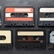 Black audio tape compact cassettes on black background - PhotoDune Item for Sale