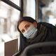 caucasian female with medical mask in urban transport - PhotoDune Item for Sale
