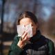 female outdoor sneeze and cover her face with napkin - PhotoDune Item for Sale