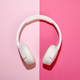 White headphones on a duo tone pink background - PhotoDune Item for Sale