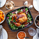 Top view of decorated festive table with whole roasted chicken - PhotoDune Item for Sale