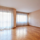Empty large room with wooden floor and white curtains in apartment interior - PhotoDune Item for Sale