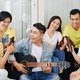 Young man singing for friends - PhotoDune Item for Sale