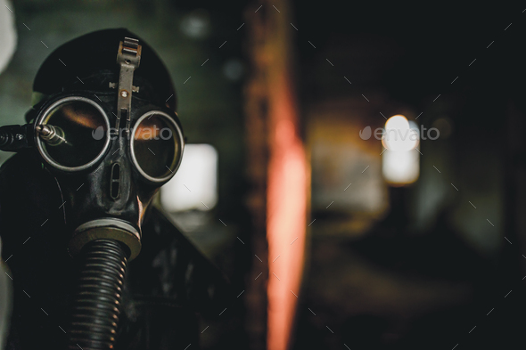 Man wearing protective gas mask for covid,covid19 and nuclear  prevention. Film look and dark tones. - Stock Photo - Images