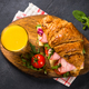 Croissant sandwich on black table - PhotoDune Item for Sale