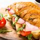 Croissant sandwich on white table - PhotoDune Item for Sale