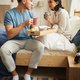 Young Couple Enjoying Breakfast in Bed - PhotoDune Item for Sale
