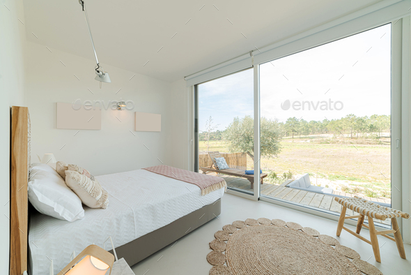 Bedroom suite in modern villa with pool and deck - Stock Photo - Images