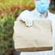 Courier, delivery man delivers online purchases during the coronavirus epidemic. - PhotoDune Item for Sale