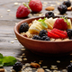 Fruit healthy muesli with banana strawberry almonds and blackberry in clay dish - PhotoDune Item for Sale