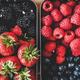 Fresh seasonal berries in metal lunchboxes, close-up, top view - PhotoDune Item for Sale