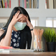 Cropped shot of Young women and laptop working at home She is stressed by the coronavirus outbreak. - PhotoDune Item for Sale