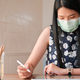 Young women and tablet working at home.She is protected from the coronavirus outbreak. - PhotoDune Item for Sale
