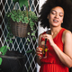 Beautiful happy black woman drinking healthy drink and smiling - PhotoDune Item for Sale