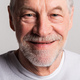 Portrait of a happy senior man with beard and mustache in a studio. - PhotoDune Item for Sale