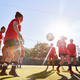 Womens Football Team Kicking Ball Whilst Training For Soccer Match On Outdoor Astro Turf Pitch - PhotoDune Item for Sale
