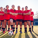 Portrait Of Smiling Womens Football Team Training For Soccer Match On Outdoor Astro Turf Pitch - PhotoDune Item for Sale