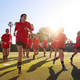 Womens Football Team Run Whilst Training For Soccer Match On Outdoor Astro Turf Pitch - PhotoDune Item for Sale