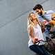 Happy young couple spending time together with dog and bicycles - PhotoDune Item for Sale