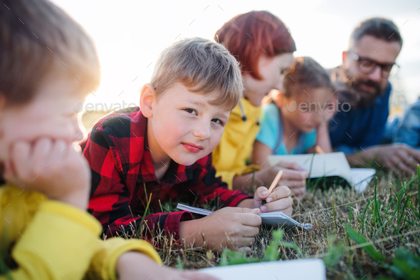 Group of school children with teacher on field trip in nature - Stock Photo - Images