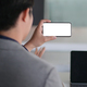 Cropped shot of A young businessman online meeting with a smartphone, He work from home. - PhotoDune Item for Sale