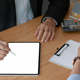 Real estate insurance agents are using tablet to recommend insurance packages to customer. - PhotoDune Item for Sale