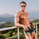 Handsome muscular man posing outdoors shirtless and in sunglasses - PhotoDune Item for Sale
