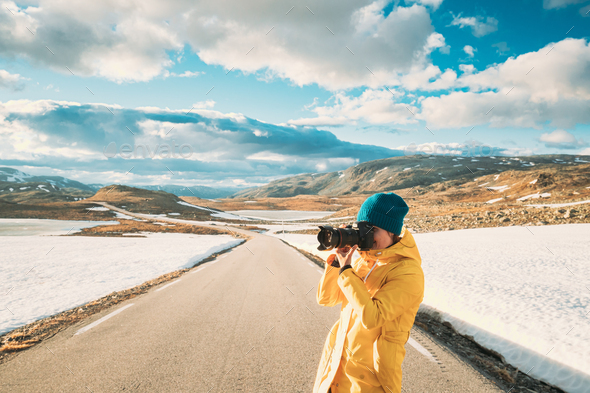 Aurlandsfjellet, Norway. Young Happy Woman Tourist Traveler Photographer Taking Pictures Photos Of - Stock Photo - Images