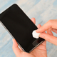 Close-up shot of Spray and wipe the alcohol to clean and kill germs on the smartphone. - PhotoDune Item for Sale