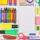 School supplies on wooden desk. Kid creativity flat lay - PhotoDune Item for Sale