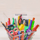 School supplies shopping cart on natural wood background - PhotoDune Item for Sale