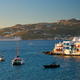 Sunset in Mykonos, Greece, with cruise ship and yachts in the harbor - PhotoDune Item for Sale