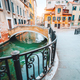 Scenic canal with bridge and colorful buildings in Venice, Italy in golden sunset light - PhotoDune Item for Sale