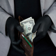 Man holding a wallet with  money dollars  in hand in black medical gloves. - PhotoDune Item for Sale
