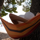 Woman relaxing in a hammock by the beach - PhotoDune Item for Sale