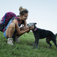 Woman patting her dog on a hike - PhotoDune Item for Sale