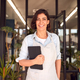 Portrait Of Female Owner Of Florists With Digital Tablet Standing In Doorway Surrounded By Plants - PhotoDune Item for Sale