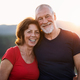 Portrait of senior tourist couple hikers standing in nature, looking at camera - PhotoDune Item for Sale