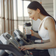 A beautiful girl in a gym on a racetrack - PhotoDune Item for Sale