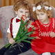Elegant little kids in a studio with bouquet of tulip - PhotoDune Item for Sale