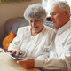 Elegant old couple in a cafe using a tablet - PhotoDune Item for Sale