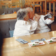 Elegant old couple in a cafe using a camera - PhotoDune Item for Sale