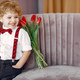 Elegant little boy in a studio with bouquet of tulip - PhotoDune Item for Sale