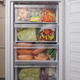 Opened freezer refrigerator with frozen meal - PhotoDune Item for Sale