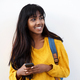 happy young Indian woman with mobile phone and bag by isolated white background - PhotoDune Item for Sale