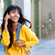 happy young Indian woman walking with mobile phone and bag - PhotoDune Item for Sale